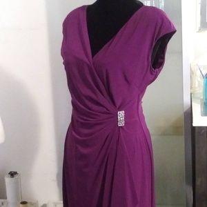 Purple pleated jeweled dress.